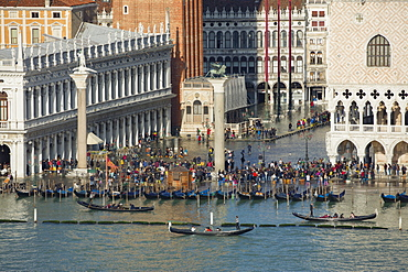 Elevated view of a busy St. Mark's Square in Venice during high tide with gondolas lined up along the shore, Venice, UNESCO World Heritage Site, Veneto, Italy, Europe