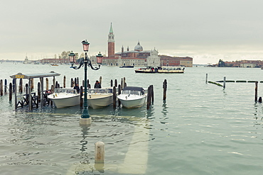 Water taxis moored beside a submerged walkway on the shores of St. Mark's Basin after the highest tide in Venice since 1966, Venice, UNESCO World Heritage Site, Veneto, Italy, Europe