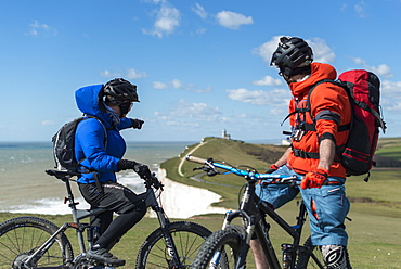 Mountain biking along the chalk cliffs coastal path on the South Downs Way near Beachy Head, South Downs National Park, East Sussex, England, United Kingdom, Europe