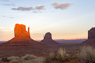 The giant sandstone buttes glowing pink at sunset in Monument Valley Navajo Tribal Park on the Arizona-Utah border, United States of America, North America