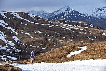 A walker at the top of the Devils Staircase while hiking along the West Highland Way near Glencoe in the Scottish Highlands, Scotland, United Kingdom, Europe