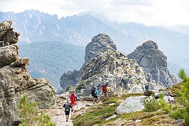 Trekking on the GR20 in Corsica near the Aiguilles de Bavella hiking towards Refuge d'Asinao, Corsica, France, Mediterranean, Europe
