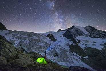 Starry sky and tent along The Walkers Haute Route from Chamonix to Zermatt, Swiss Alps, Switzerland, Europe