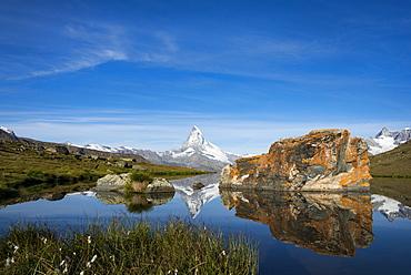 The Matterhorn from Stellisee lake in the Swiss Alps, Switzerland, Europe