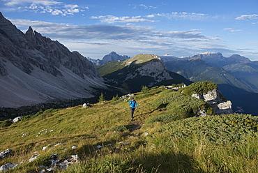 Trekking near Monte Civetta in Dolomites range near Rifugio Tissi along the Alta Via 1 trail, Belluno, Veneto, Italy, Europe