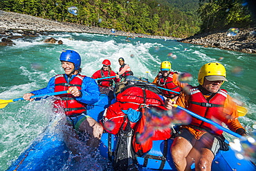 Rafting through white water rapids on the Karnali River in west Nepal, Asia