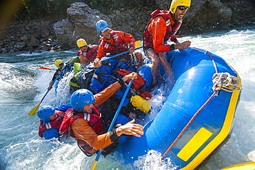 Rafters capsize as they go through some big rapids on the Karnali River, Nepal, Asia