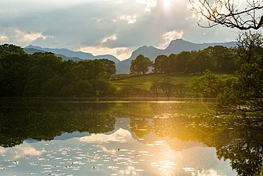 Sunset at Loughrigg Tarn near Ambleside in The Lake District National Park, Cumbria, England, United Kingdom, Europe