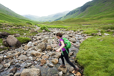 Trekking along Mickeldon Valley in Great Langdale towards Bowfell in the Lake District National Park, Cumbria, England, United Kingdom, Europe