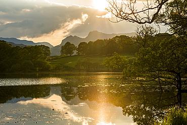 Sunset at Loughrigg Tarn near Ambleside, Lake District National Park, Cumbria, England, United Kingdom, Europe