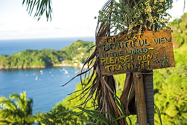 A sign asking readers not to trash the most beautiful view in the world at Castara Bay in Tobago, Trinidad and Tobago, West Indies, Caribbean, Central America