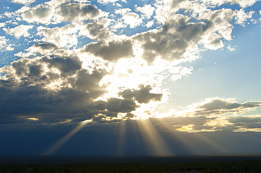 Beams of sunlight shine down to earth, Catamarca, Argentina, South America