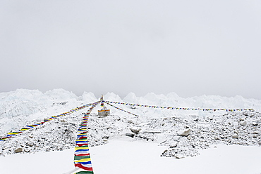 A puja adorned with prayer flags on the Khumbu glacier at Everest Base Camp, Khumbu Region, Nepal, Himalayas, Asia
