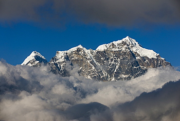 A view of Taboche through the clouds seen from Kongde in the Everest region, Nepal, Himalayas, Asia