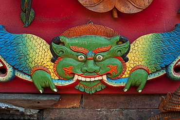 A vibrantly painted deity on display in the historical Newar city of Bhaktapur, Nepal, Asia