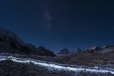Departure of the Sherpas, their head-torches leaving trails of light across the glacier on their way to Everest, Nepal, Himalayas, Asia