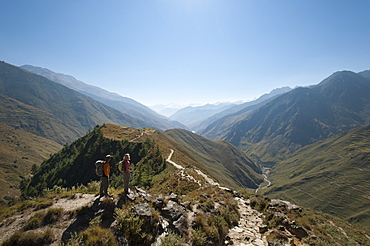 Taking a pause from the trail at a viewpoint in the Juphal Valley, Nepal, Himalayas, Asia