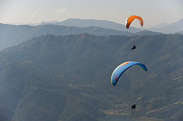 Paragliders flying above Pokhara, Nepal, Himalayas, Asia