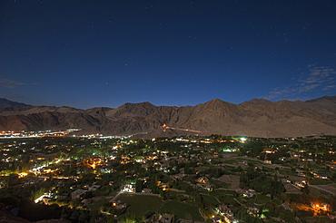 Leh, the capital city of Ladakh glows at night, Ladakh, India, Asia