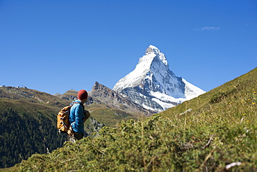Trekking in the Swiss Alps near Zermatt with a view of the Matterhorn in the distance, Zermatt, Valais, Switzerland, Europe