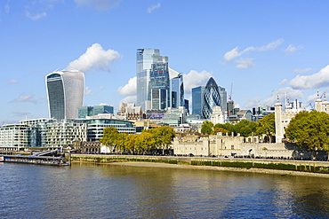 City of London skyscrapers and the Tower of London viewed across the River Thames, London, England, United Kingdom, Europe