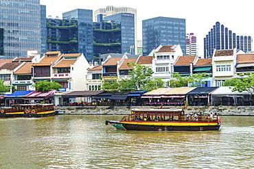 Tour boat passing Boat Quay, Singapore, Southeast Asia, Asia