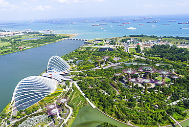 High view overlooking the Gardens by the Bay botanical gardens with its conservatories and Supertree Grove, Singapore, Southeast Asia, Asia