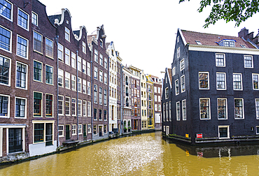 Old gabled buildings by a canal, Oudezijds Kolk, Amsterdam, North Holland, The Netherlands, Europe