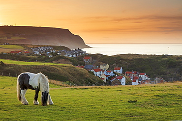 Staithes fishing village and distant Boulby Cliffs on the North Yorkshire Heritage Coastline, Staithes, Yorkshire, England, United Kingdom, Europe - 1228-222
