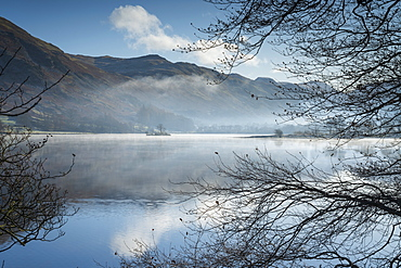 Dawn light and transient sunlit mist over Wall Holm Island on Ullswater, Lake District National Park, UNESCO World Heritage Site, Cumbria, England, United Kingdom, Europe