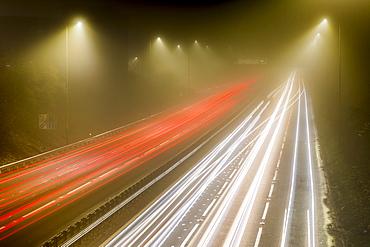 Motorway traffic trail lights at night, M8, Scotland, United Kingdom, Europe