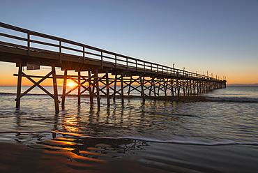 Pier at sunset on Sunset Beach in North Carolina, USA, North America