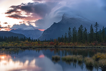 Sunrise and storm clouds at Vermillion Lakes with Mount Rundle in autumn, Banff National Park, UNESCO World Heritage Site, Alberta, Rocky Mountains, Canada, North America