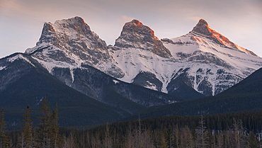Evening light on the peaks of Three Sisters near Banff National Park, Canmore, Alberta, Canadian Rockies, Canada, North America