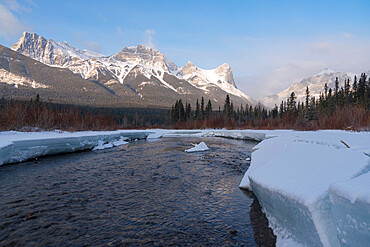 Policeman's Creek in winter with Ha Ling Peak at sunrise, Bow Valley Provincial Park, Canmore, Canadian Rockies, Alberta, Canada, North America