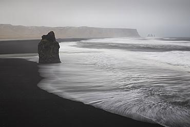 Reynisdrangar basalt rock columns and black sand beach in Vik, Iceland, Polar Regions