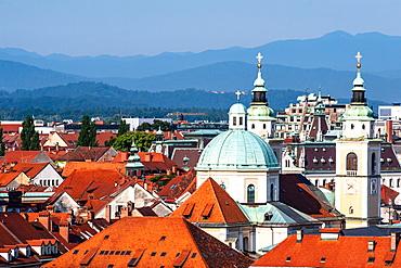 City rooftops with mountains, Ljubljana, Slovenia, Europe