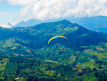 Paraglider soars near Jardin, Antioquia, Colombia, South America