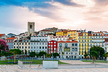 Traditional buildings with azulejo tiles in the old Lisbon neighbourhood of Alfama with Se Cathedral in background, Lisbon, Portugal, Europe