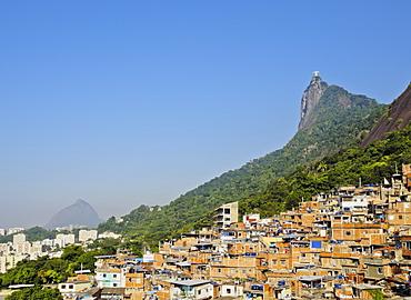 View of the Favela Santa Marta with Corcovado and the Christ statue behind, Rio de Janeiro, Brazil, South America