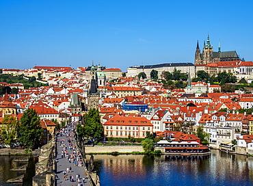 View over Vltava River and Charles Bridge towards Lesser Town and Castle, Prague, UNESCO World Heritage Site, Bohemia Region, Czech Republic, Europe