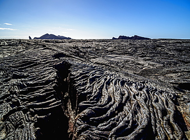View over Lava field in Sullivan Bay towards Bartolome Island, Santiago (James) Island, Galapagos, UNESCO World Heritage Site, Ecuador, South America