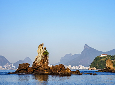 View over Icarai Rocks towards Boa Viagem Island, Corcovado Mountain and Pedra da Gavea, Niteroi, Rio de Janeiro State, Brazil, South America