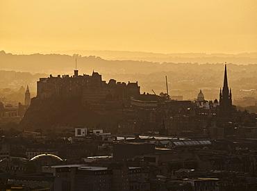 Holyrood Park, sunset over the city of Edinburgh viewed from the top of the Arthur's Seat, Edinburgh, Lothian, Scotland, United Kingdom, Europe