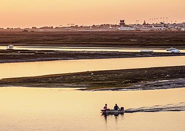 View towards Ria Formosa Natural Park at sunset, Faro, Algarve, Portugal, Europe