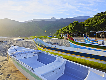 Traditional colourful boats on the beach in Bonete, Ilhabela Island, State of Sao Paulo, Brazil, South America