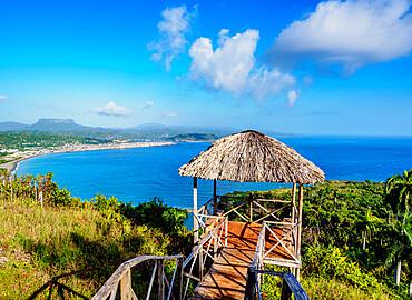 View over Bahia de Miel towards city and El Yunque Mountain, Baracoa, Guantanamo Province, Cuba, West Indies, Caribbean, Central America
