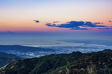 View over Blue Mountains towards Kingston at dawn, Saint Andrew Parish, Jamaica, West Indies, Caribbean, Central America