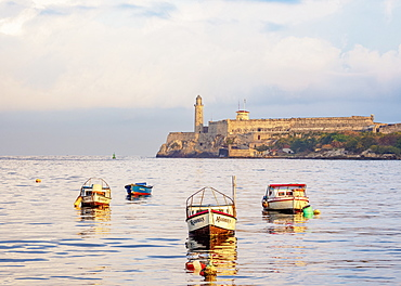 Fishing Boats and El Morro Castle at sunrise, Havana, La Habana Province, Cuba, West Indies, Central America
