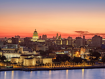 View over Castle of the Royal Force (Castillo de la Real Fuerza) and Habana Vieja towards El Capitolio at dusk, UNESCO World Heritage Site, Havana, La Habana Province, Cuba, West Indies, Central America